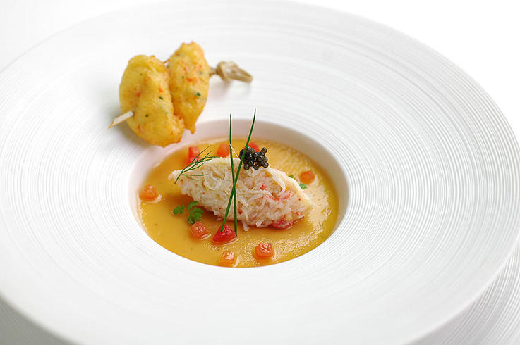 Snow crab in consommé  jelly perfumed with galangal, flaked snow crab,  little accra fritters
