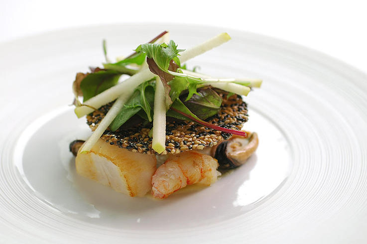 Scallops, langoustines and mussels  with green apple,  sesame tuile and herb salad